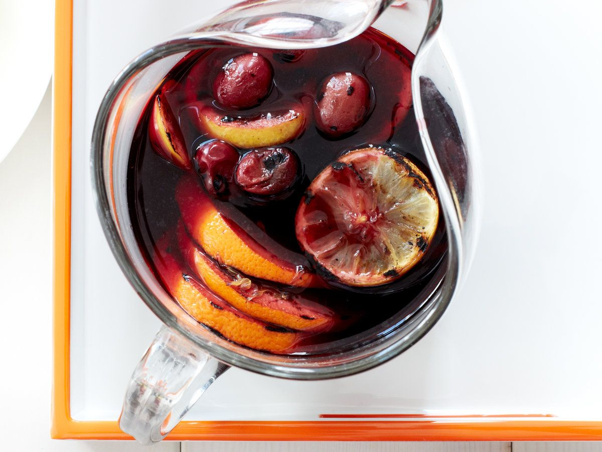 Grilled Citrus And Grape Sangria This Delicious Sangria Features Grilled Lemons Oranges And Grapes In Either Red Sangria Recipes Wine Recipes Summer Drinks