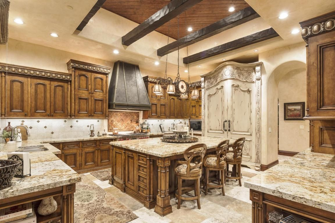 Mediterranean Style Kitchen With Recessed Lighting And Exposed Wooden Beams That Compliment The Tuscan Kitchen Design Mediterranean Kitchen Design Tuscan House