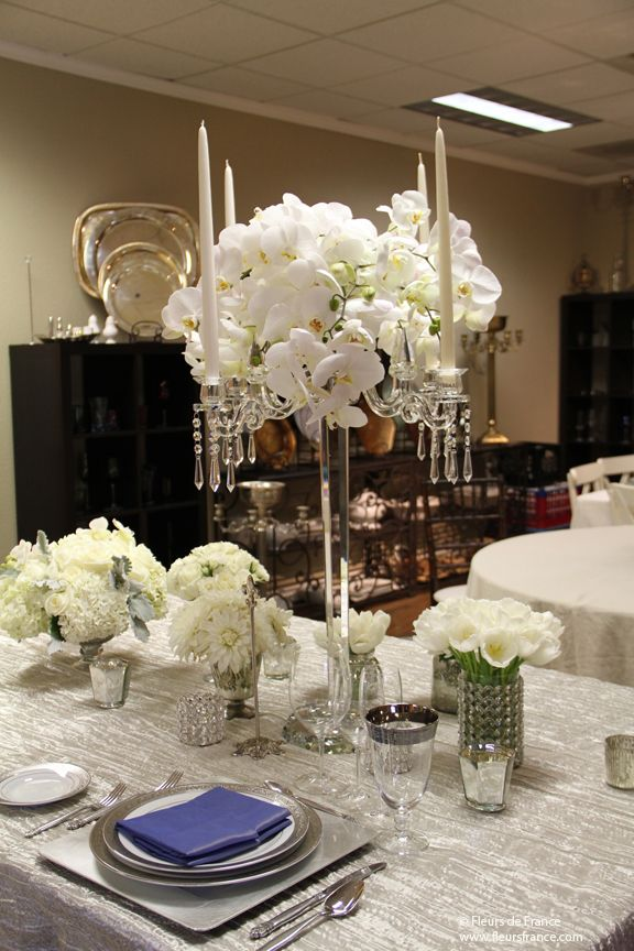 Tall crystal candelabra will hanging drape more