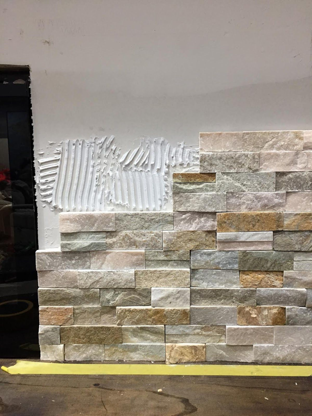 How To Install Stacked Stone Tile On A Fireplace Wall