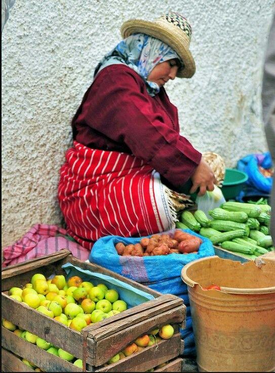 Jebala woman selling her fresh grown produce in the sooq (market).