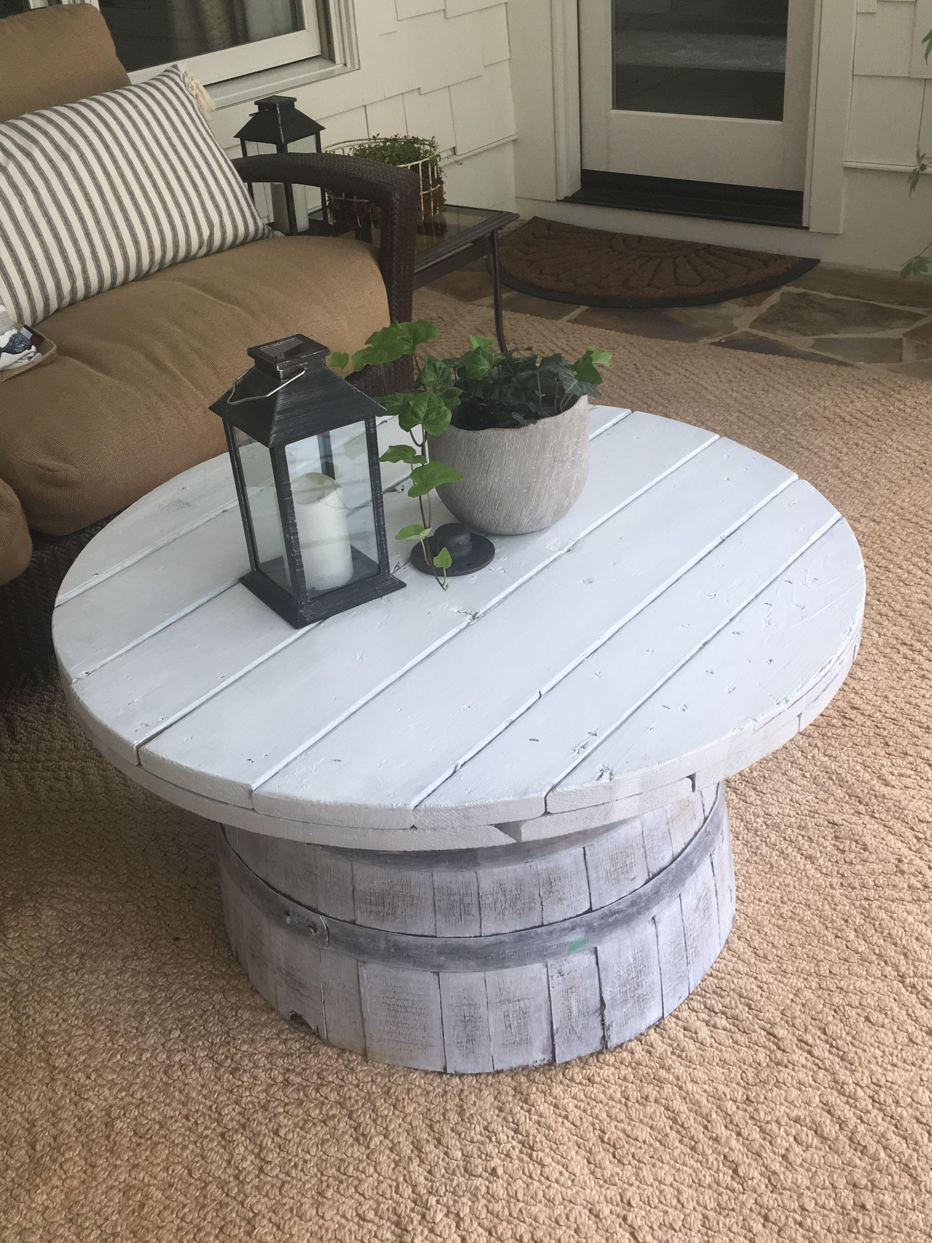 Repurposed half barrel and spool top make a great outdoor patio