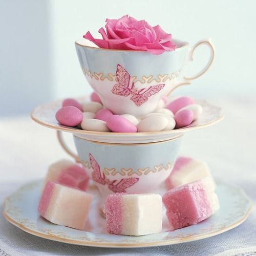 Blue and pink tea cups and saucers with gold trim.