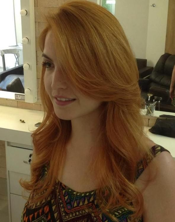 Long Side Parted Strawberry Blonde Hairstyle
