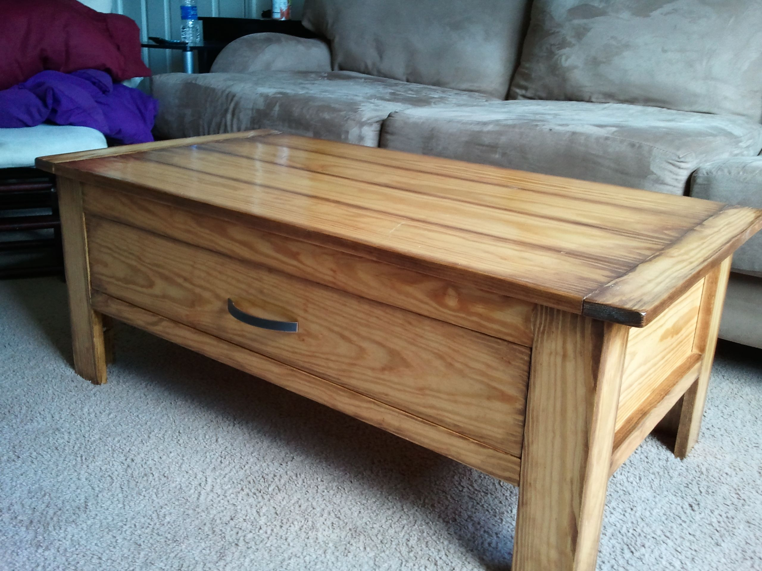 Coffee table with a massive drawer coffee table