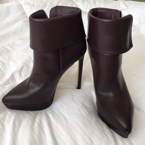 Dark brown high heeled booties  Dark brown in color. Zipper on the outside. Incredibly cute with skinny jeans or short dress.  Only worn once unfortunately I have to part with them because I am preggers and cannot be strutting around in those  Shoes Heeled Boots