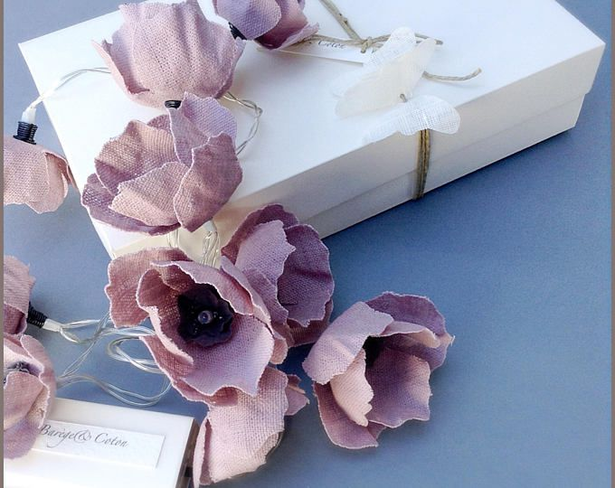 Guirlande lumineuse fleurs de lin rose décoration d interieur