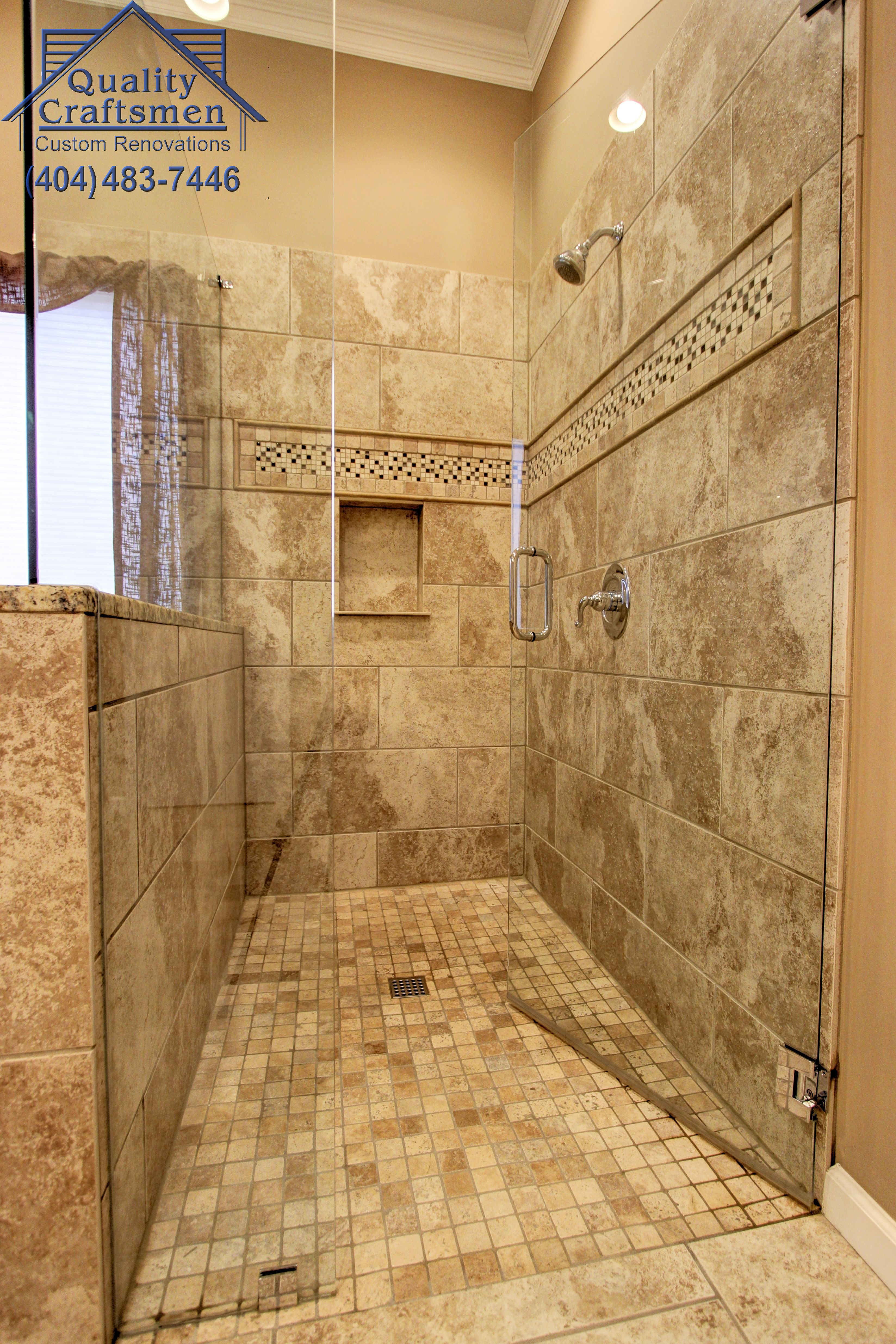 . No curb walk in master shower  Travertine tile and recycled glass