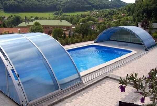 Telescopic Glass Enclosures With Sliding Segments Promising Enjoyable Swim Rain Or Shine Swimming Pools Pool Enclosures Pool Cover