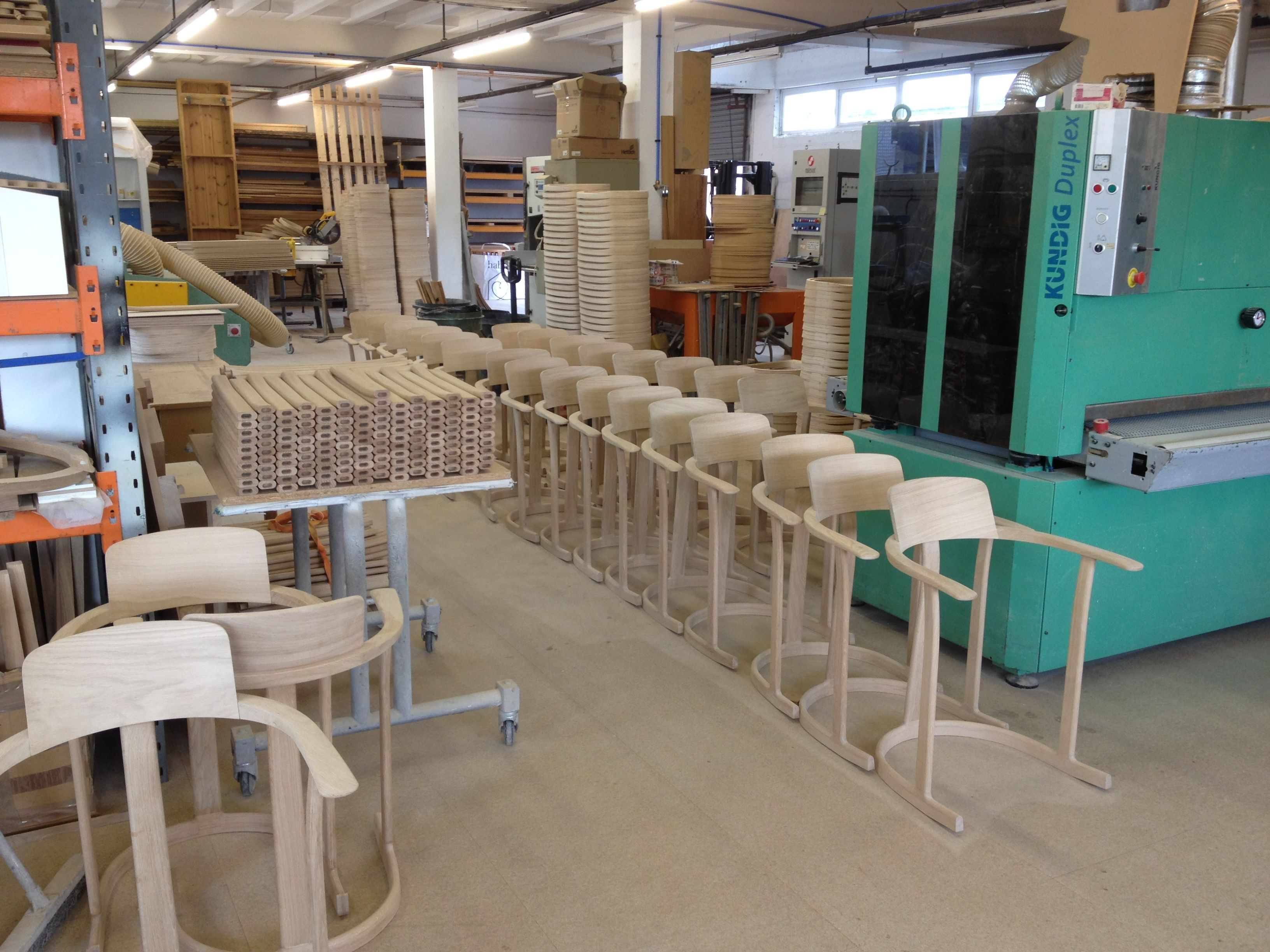 Bodleian Libraries Chairs lining up in the workshop as production is