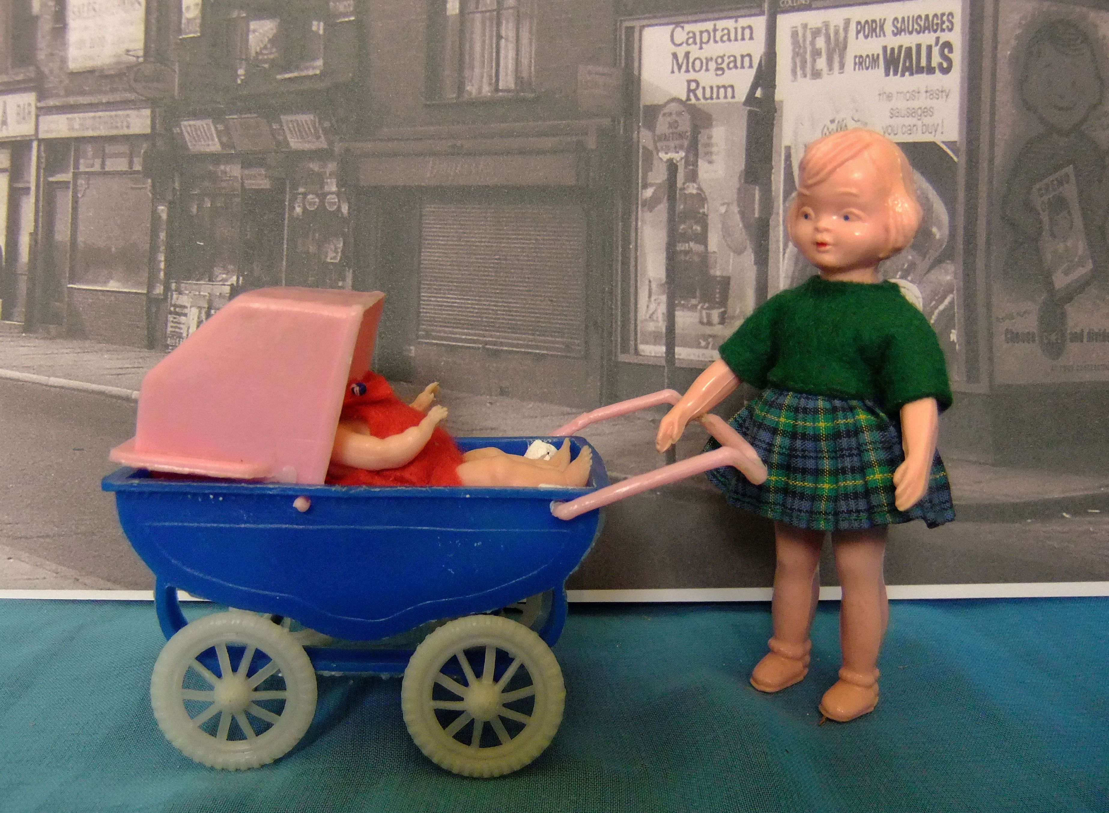 "1960 s Dibro 4 8"" hard plastic doll with plastic baby doll and plastic pram Made in"
