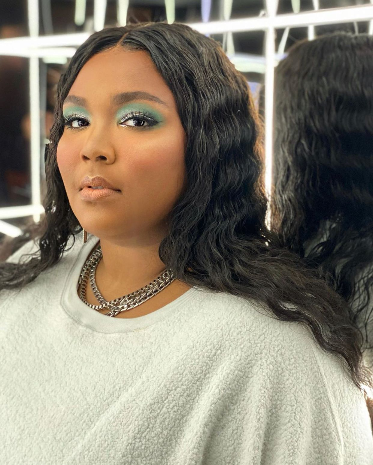 Lizzo is Being Sued By That Postmates Driver and Quite