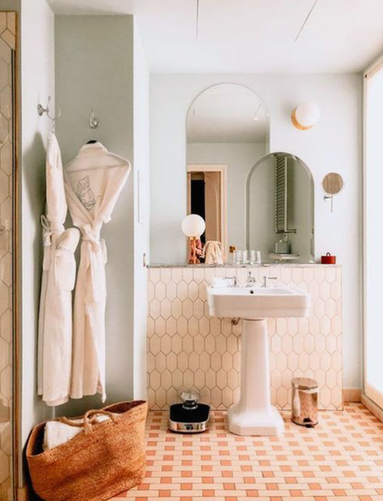 Double Arched Mirrors In A Bathroom