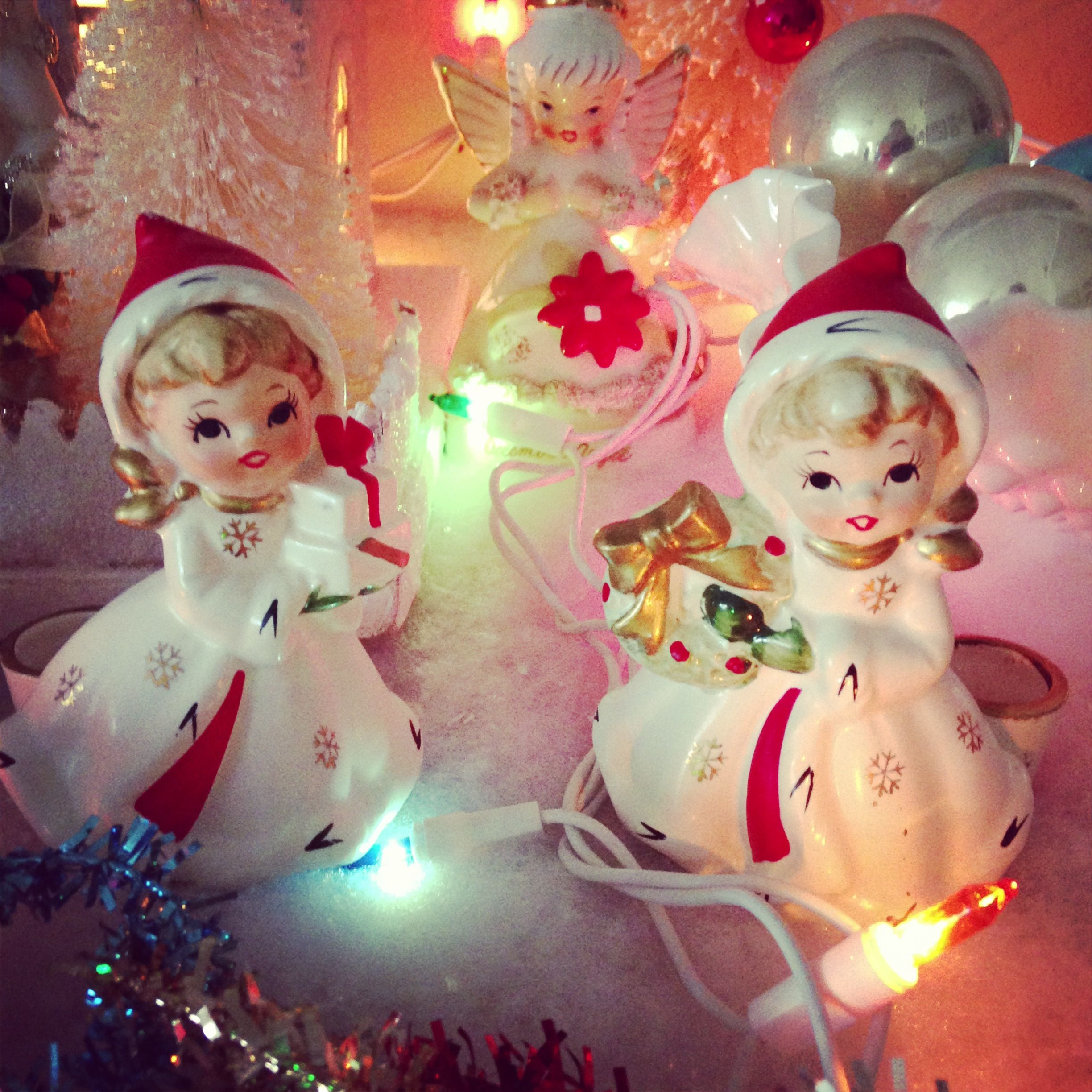 Leaning towards vintage Christmas angels and bottle brush trees for