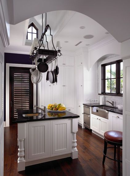 A little bit of Beadboard cabinetry adds visual interest ...