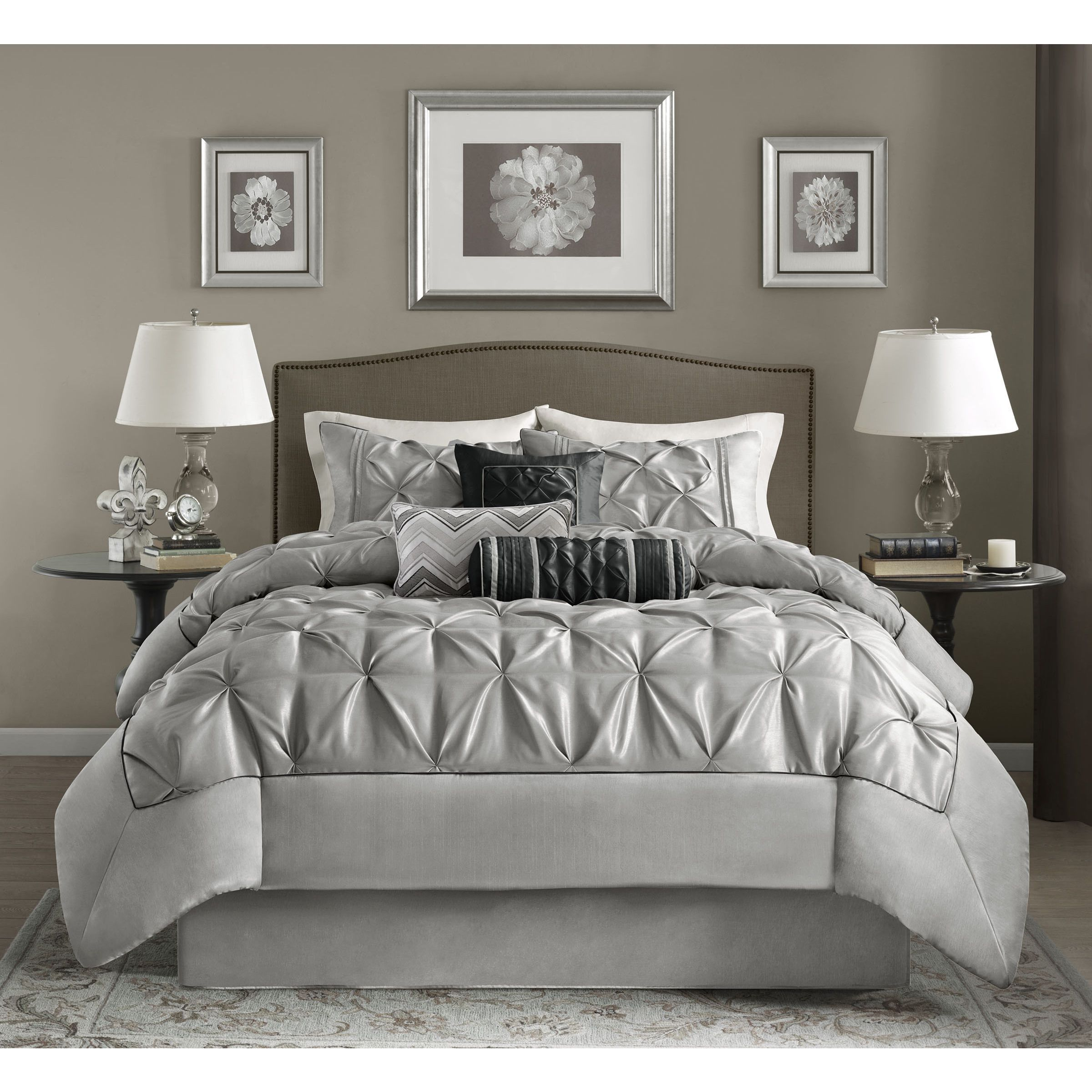 this beautifully tufted bed is from the cynthia bedding collection