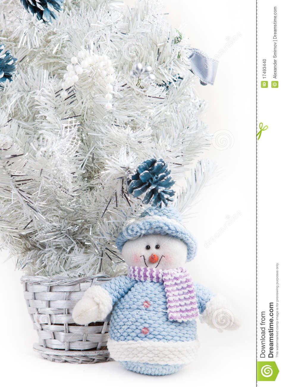 Toy Snowman Next To A White Christmas Tree - Download From Over 27 Million High Quality Stock Photos, Images, Vectors. Sign up for FREE today. Image: 17493440
