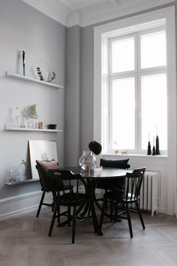 A Round Dining Table In The Corner Of An Open Plan Living Space