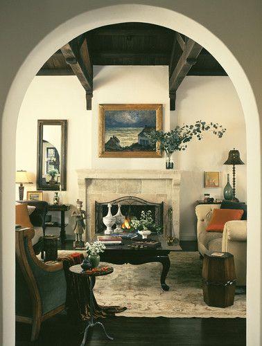 mediterranean living room, dark wood ceilings, light walls ...