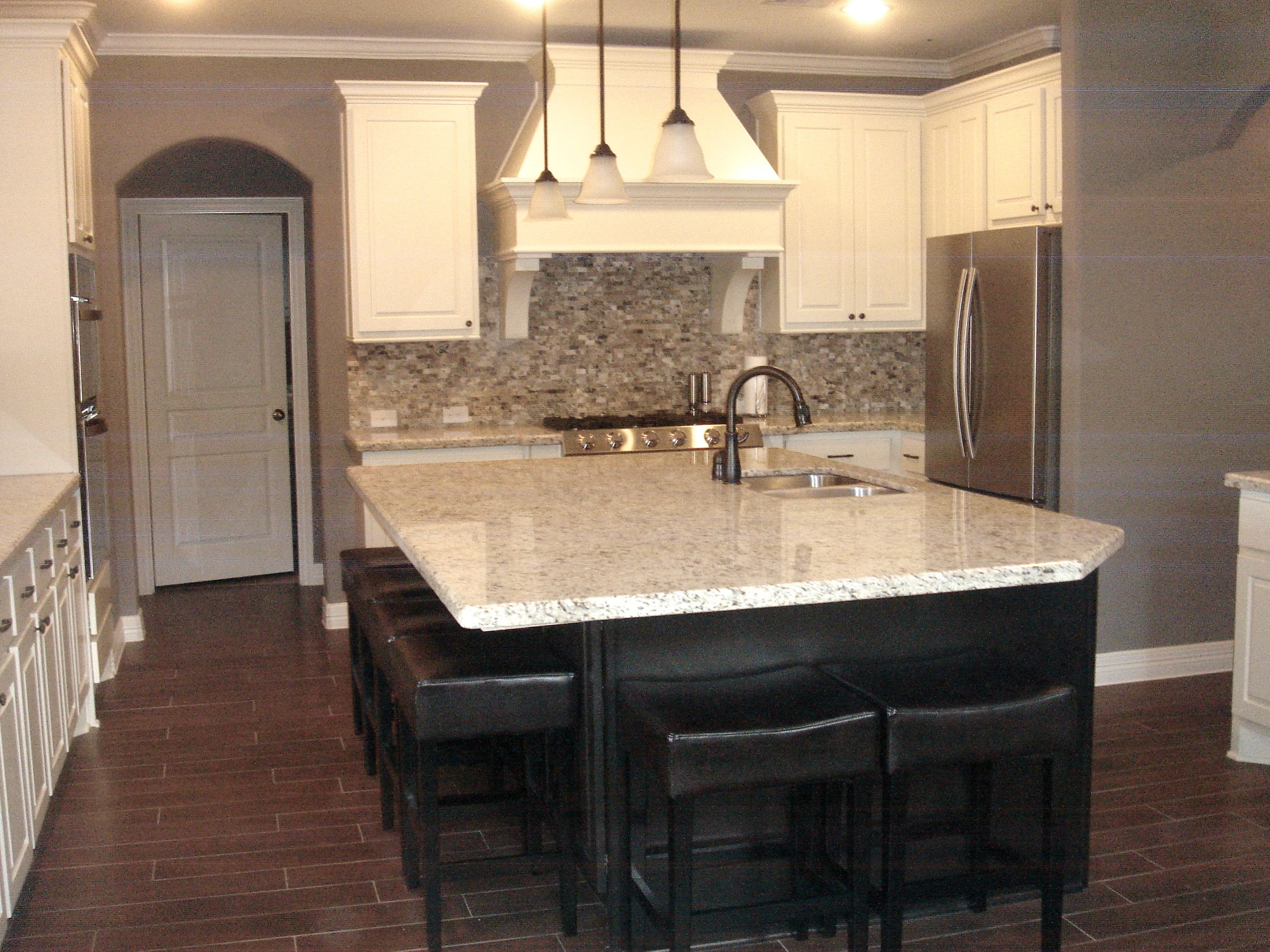 kitchen wood look tile dark island white cabinets light granite
