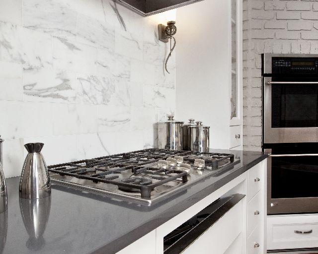 gray quartz countertops calcutta gold marble backsplash gorgeous