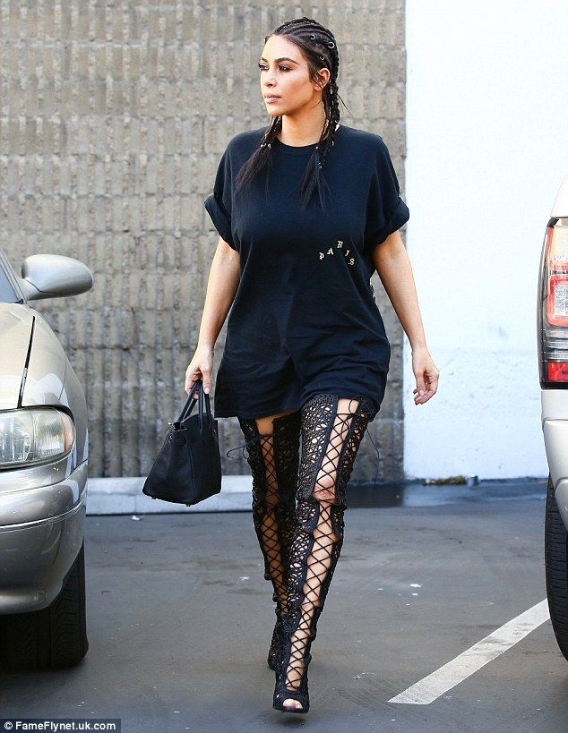 Stride: The wife of rapper Kanye West strutted out to her car in the provocative high heeled boots
