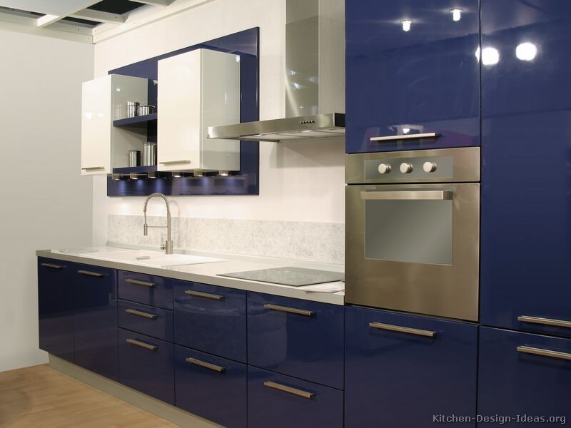 navy blue and white kitchen Then bined with red accessories