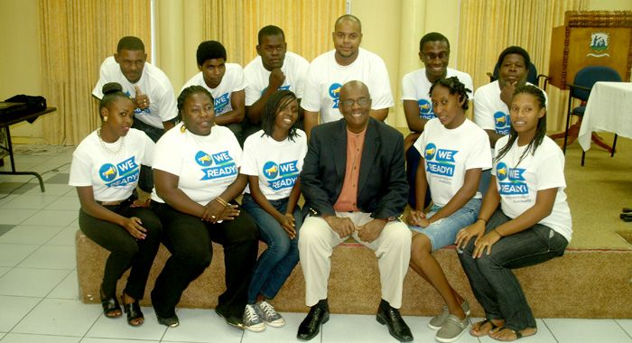 President of the NDP, Arnhim Eustace pose with Young Democrats after the launch of the app. (IWN Photo)
