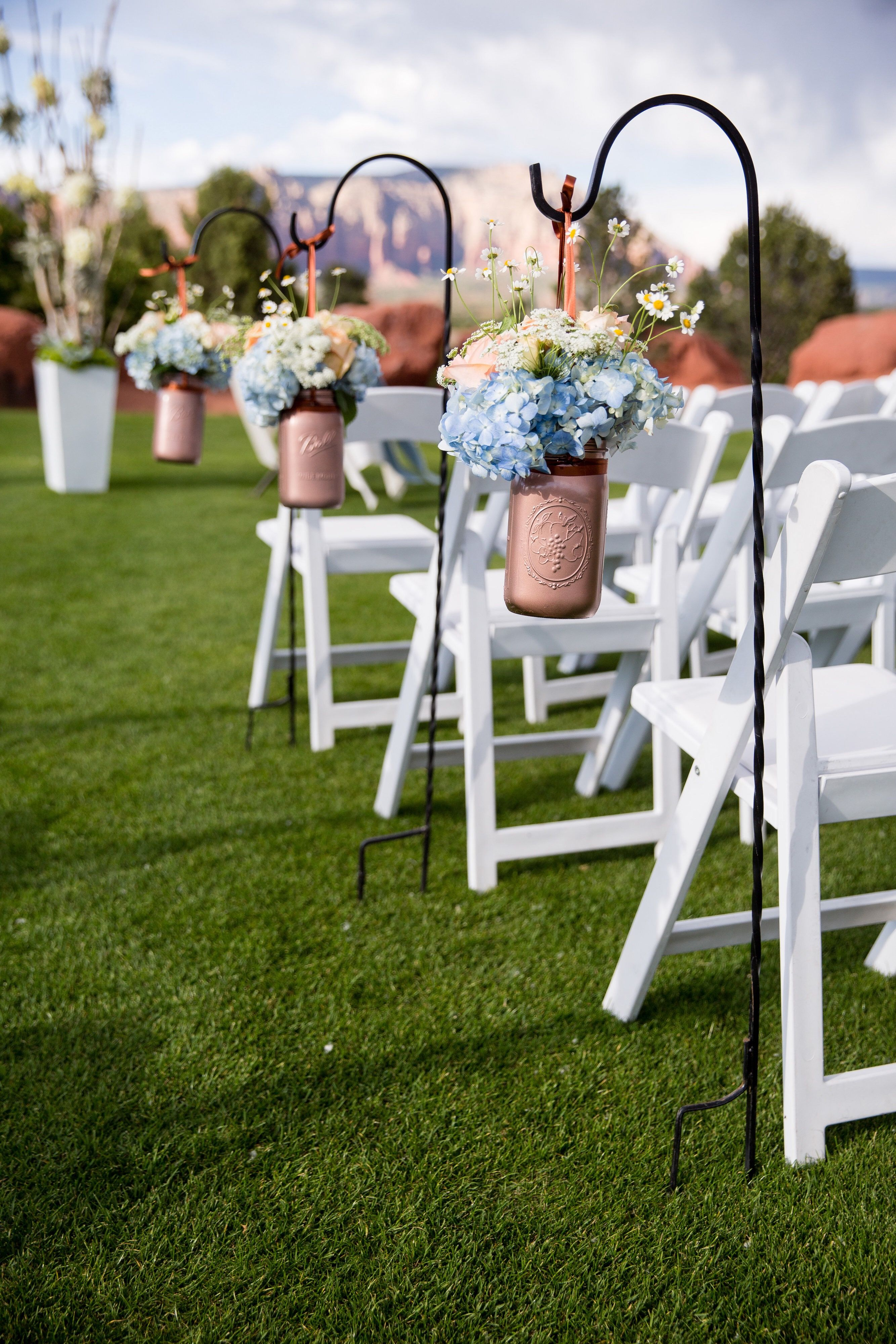 Copper Painted Mason Jars With Blue Hydrangea Peach Roses And