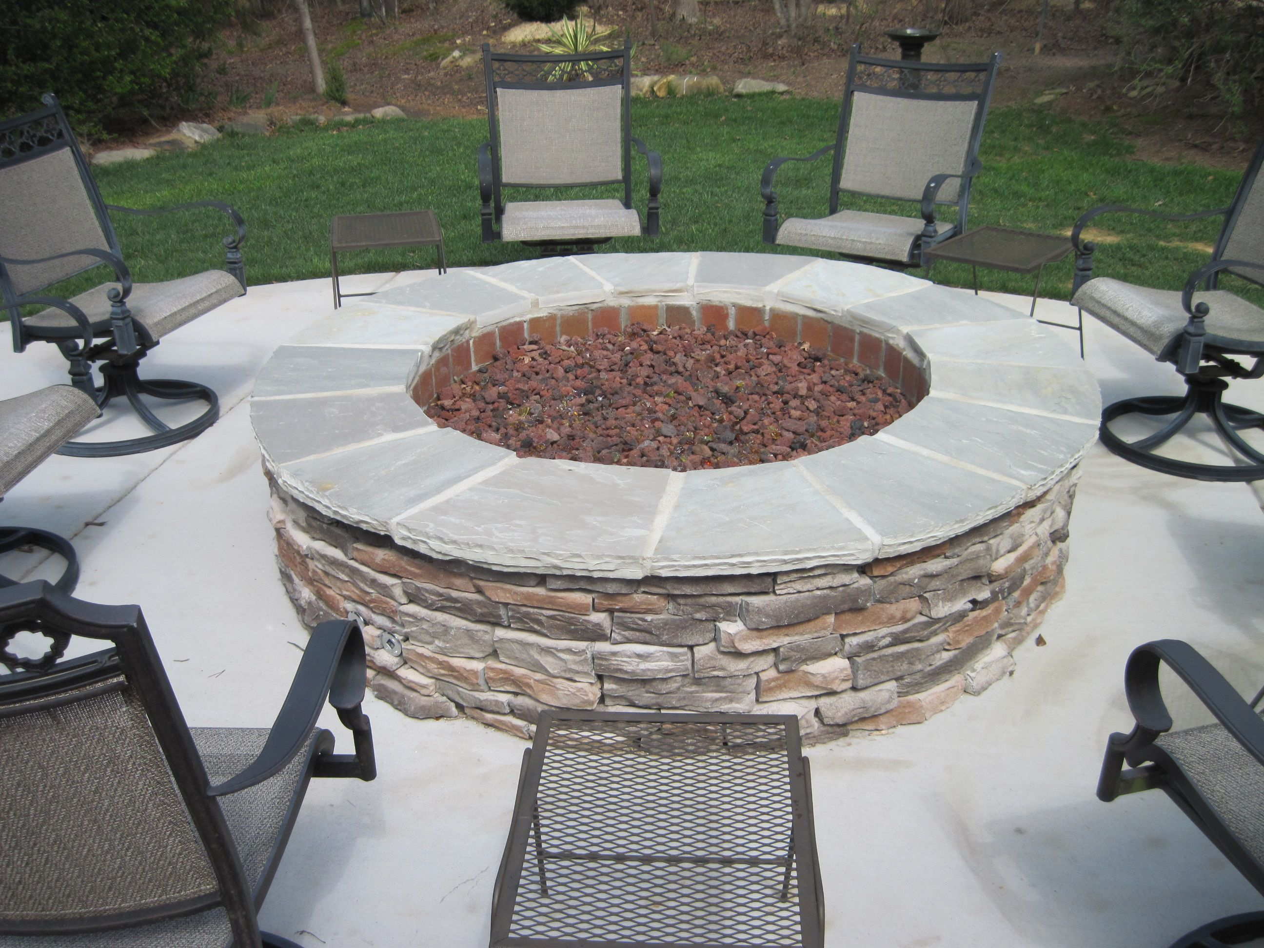 a perfect large gas fire pit with coronado ledge stone by archadeck