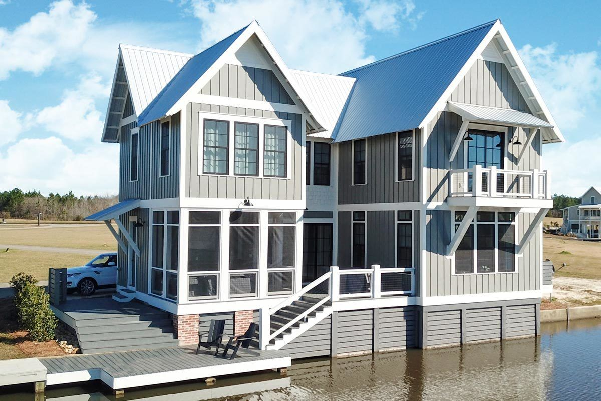 Waterfront Dog Trot House Plan with Great Outdoor Spaces
