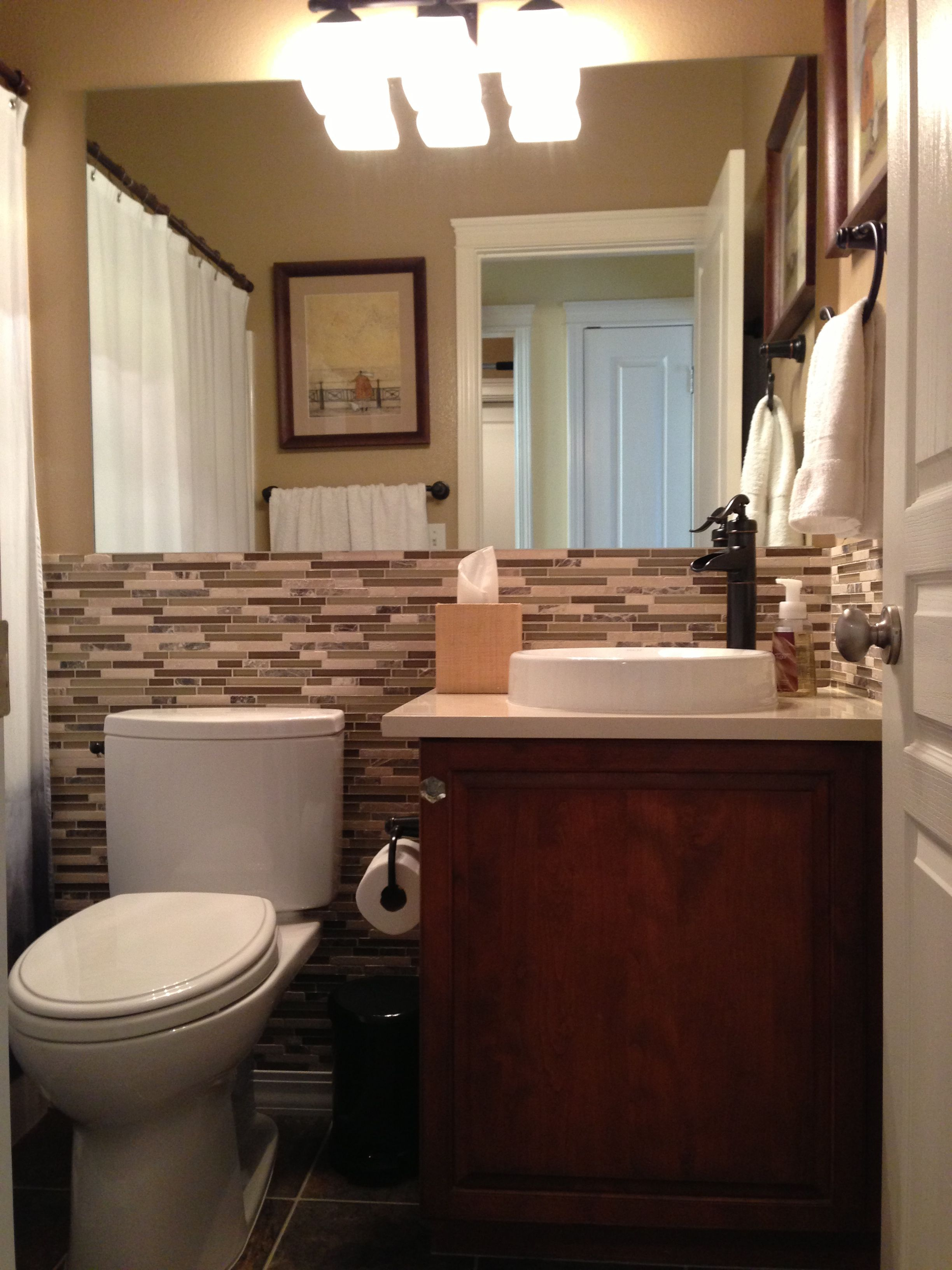 Tranquil bathroom Pfister Faucet Kohler Sink Toto Toilet glass tile and stone