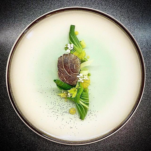 Pan-fried and torched cod, pak choi, lemon, herbs by kamil cichy