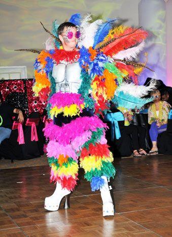 An Elton John tribute artist performed in costumes inspired