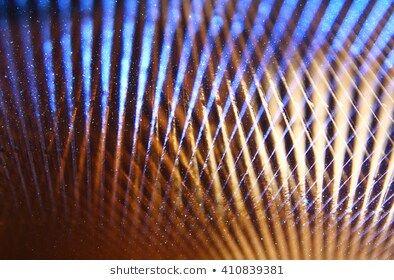 metallic glitter vintage lights background blue silver gold and black defocused