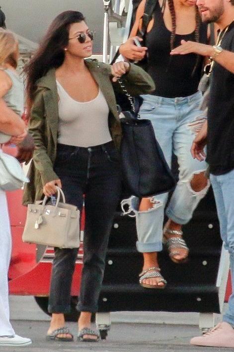 2893fe1518a1eb Kourtney Kardashian wearing Hermes Birkin Bag, House of CB Luca Bodysuit in  Nude, Re/Done Straight Skinny Jeans and Chanel Chain Slides