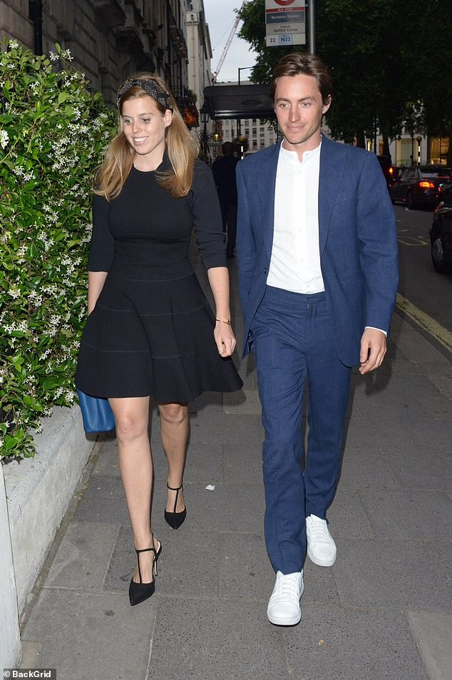 Princess Beatrice's boyfriend links hands with her and