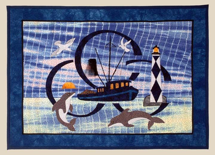 """Sea, Sea, Sea - 23"""" x 32"""" - The shrimp trawler and the three large """"C's"""" are the logo for Carteret Community College (where I worked). The lighthouse is our local Cape Lookout Lighthouse.  The college is referred to as CCC; hence the name of the quilt."""