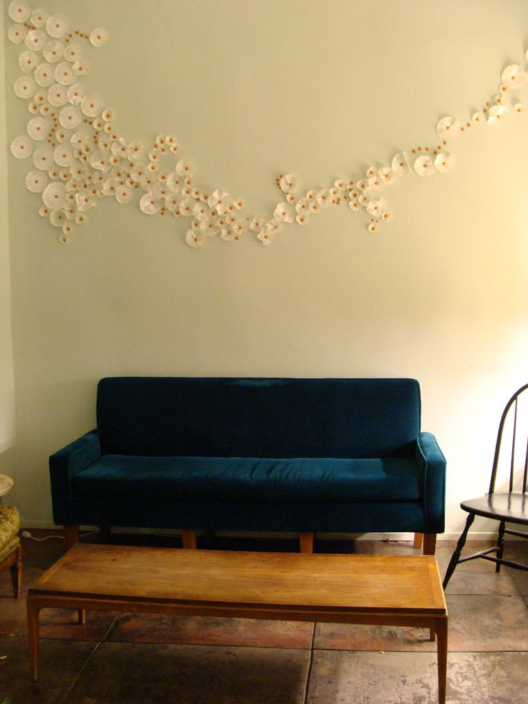 Sitting area inside bakerycafe lights flats and walls
