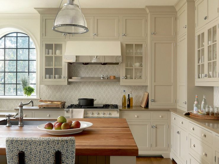 Traditional Kitchen With Tan Cabinets Accented Nickel Latch Cabinet Hardware And White Drawer Pulls Alongside