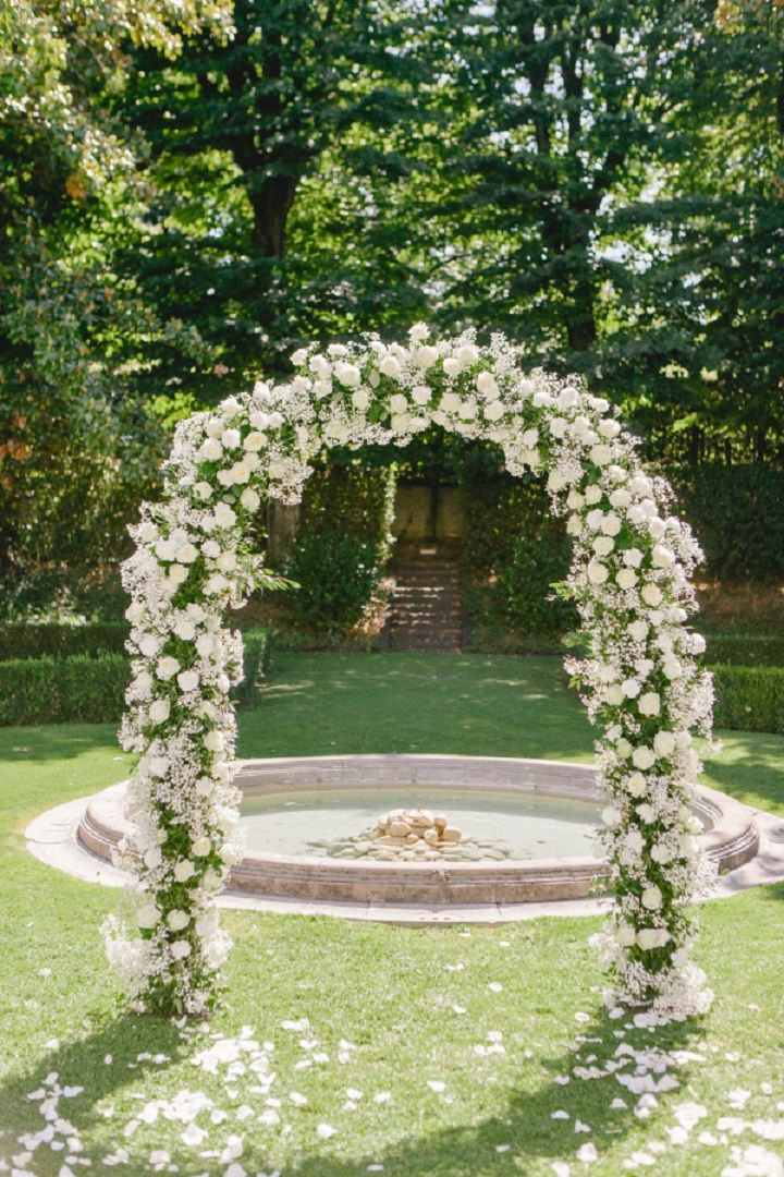 Floral wedding ceremony arch in the garden for a Breathtaking Fairytale Venice Wedding + Steven Khalil wedding dress | itakeyou.co.uk #wedding #weddingceremony #floralarch #fairytalewedding