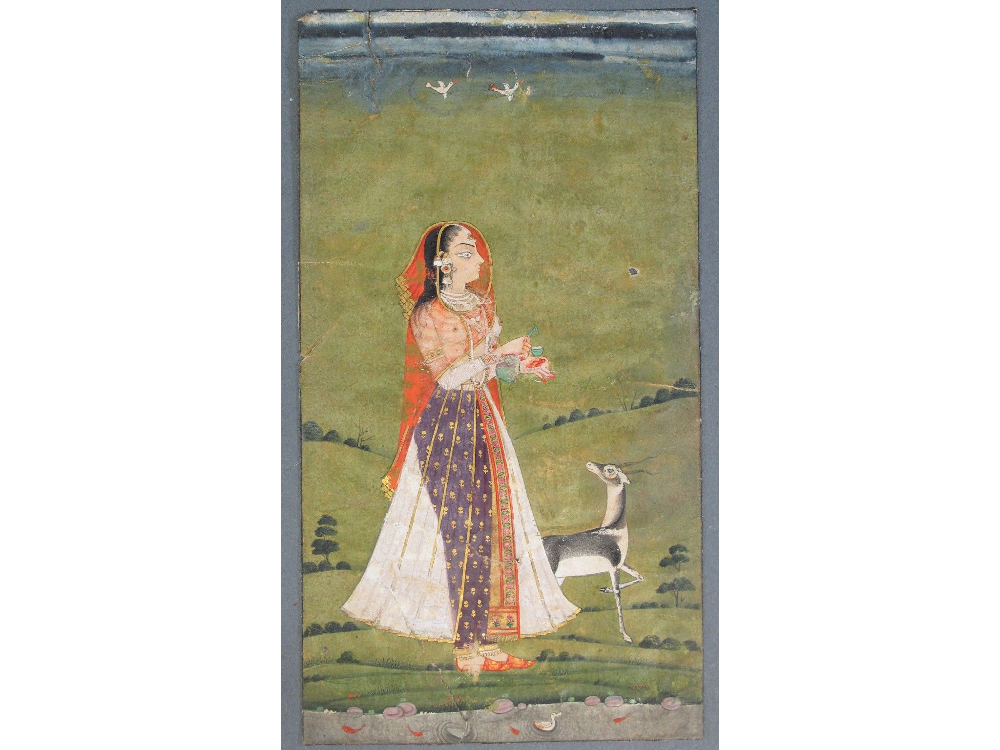 A LADY WITH A DEER Deccan Southern India 18th century gouache with gold and