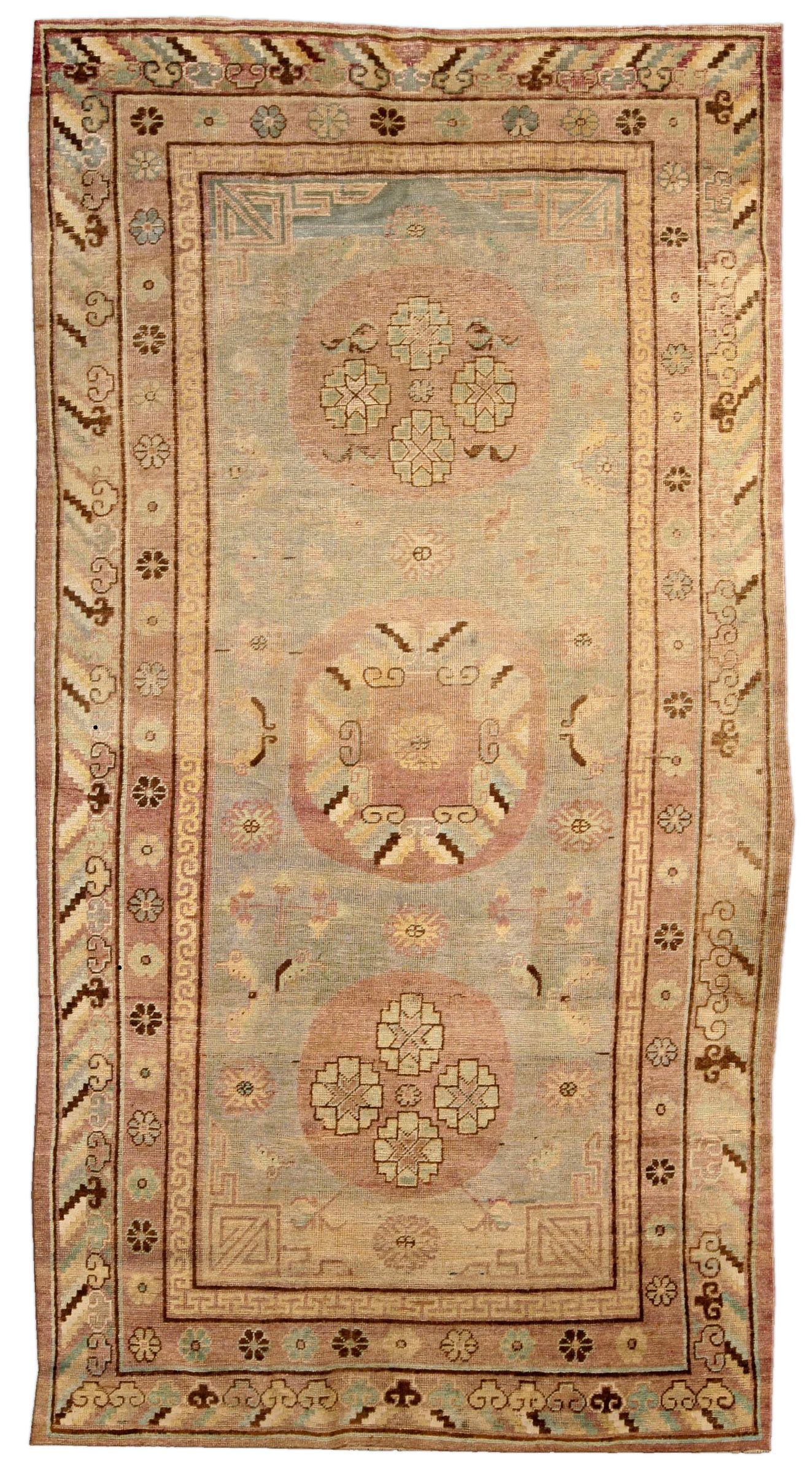 A Samarkand rug BB4111 - An early 20th century Samarkand (Khotan) rug, the celadon field with scattered floral motifs and key-pattern ...