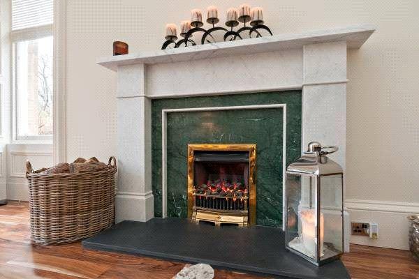 a beautiful decorative fireplace in this edinburgh town house