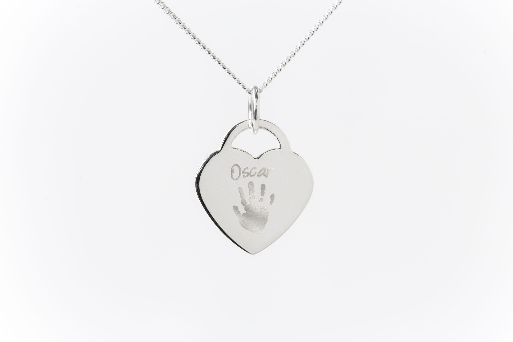 Sterling silver engraved heart charm and name and hand print.