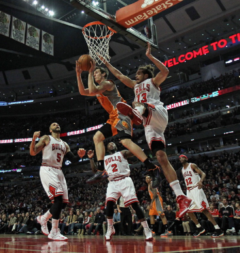 cfc4c4269836 ... Phoenix Suns leaps to pass over (L-R) Carlos Boozer Nate Robinson and  Joakim Noah of the Chicago Bulls at the United Center on 12 Jan 2013 in  Chicago