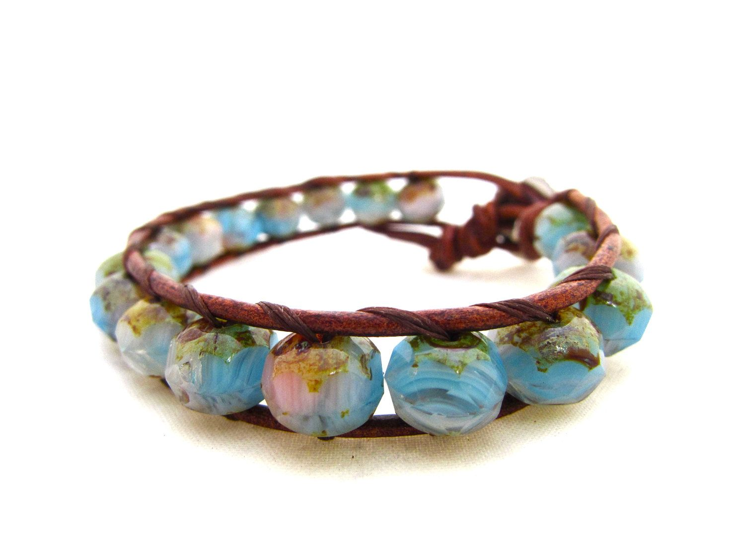 Cottage Chic Beach Wrap Bracelet HandMade on Maui, Hawaii. Opalescent Picasso Czech Glass With Flower Button. Pink Aqua Brown and Green. $42.00, via Etsy.