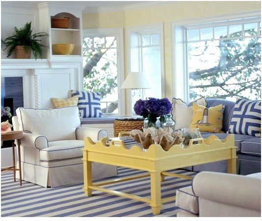 Love the yellow coffee table in an otherwise neutral blue and white living room