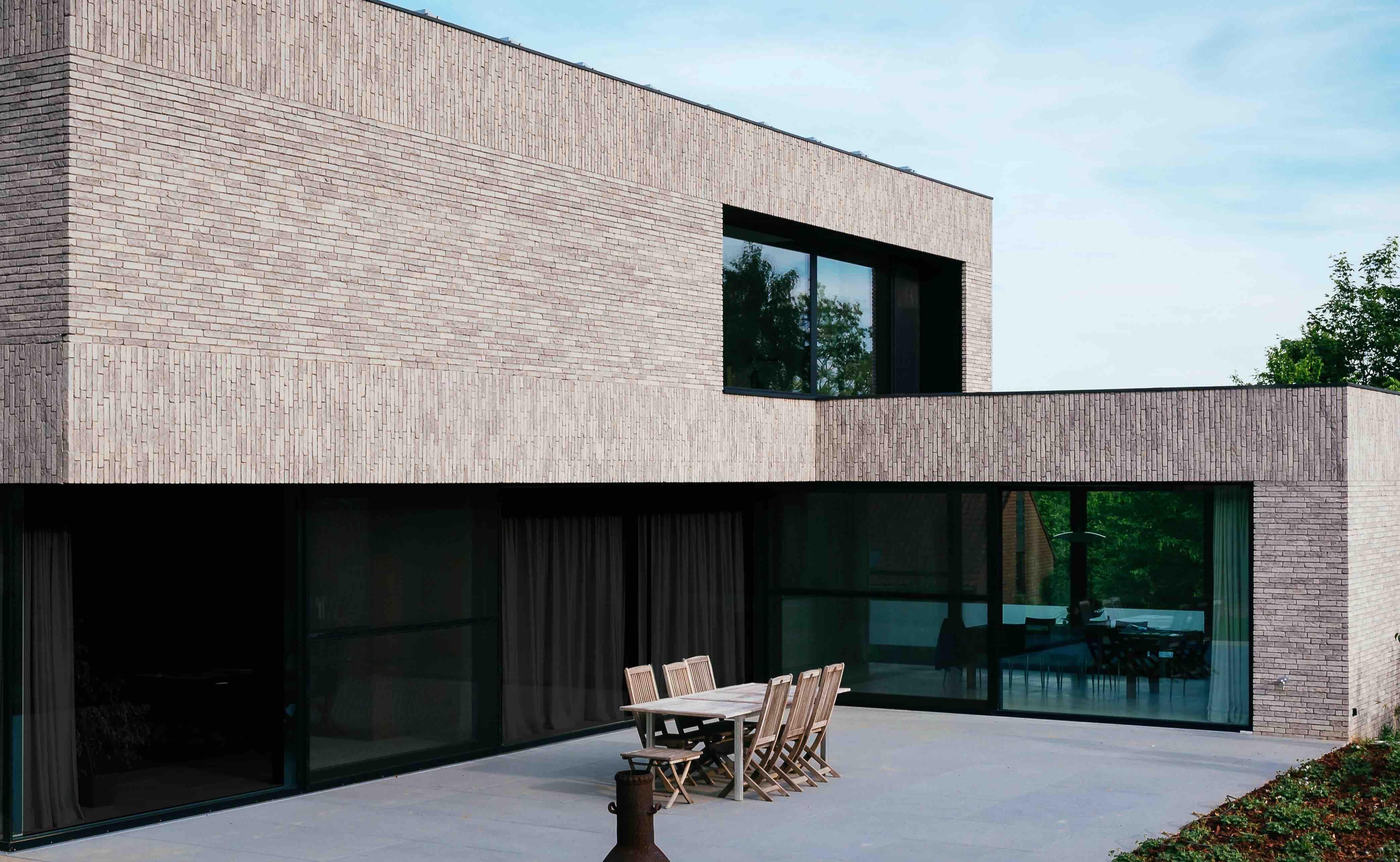 Gevelsteen indienmoderne blok huis in