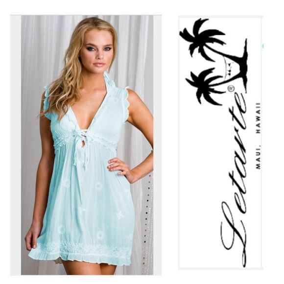 Letarte Light Blue Embroidered Swimwear Cover Up M This light blue swimwear cover up by Letarte is oh so cute. As model Brooklyn Decker shows in pic, it can also be worn out as a dress! It has  has white embroidery detail, ruffled edges and a ruffled band at the middle with a tie right at the bust line for extra support.  100% Cotton. Might trade for another high end cover up. Letarte  Dresses Mini